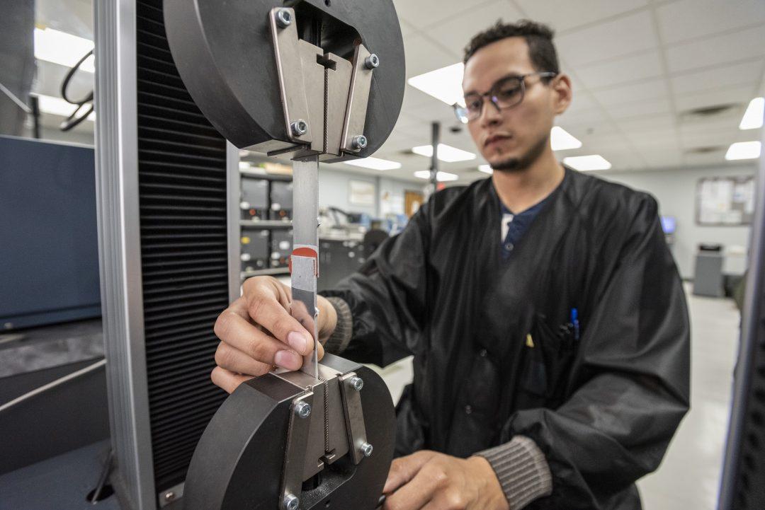 Testing lap shear in the Appli-Tec QC lab.